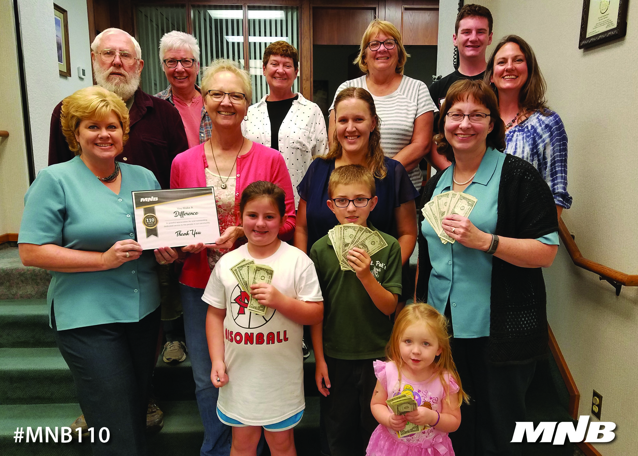 MNB presents $110 donation to The Thinkery of Southwest Nebraska